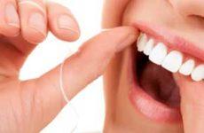 Как правильно пользоваться зубной нитью?